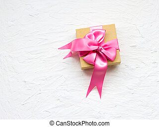 gift box with gift tag. pink satin gift bow