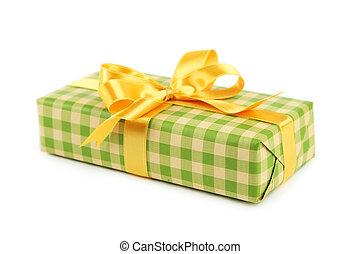 Gift box with golden bow isolated on white