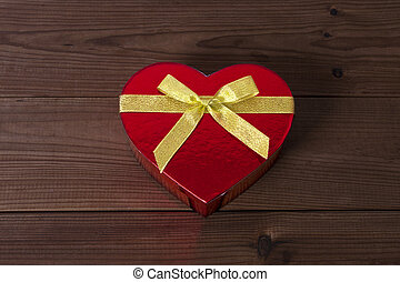 gift box with heart shape on wood