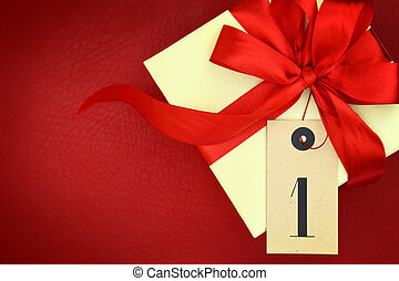 Gift box with number one and ribbon on red background