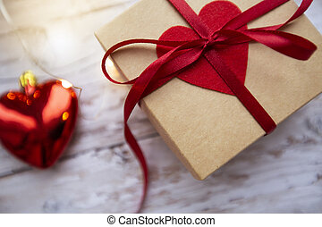 gift box with red heart on wooden background, valentines day