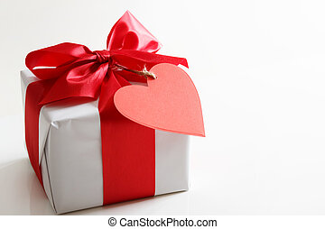 Gift box with red heart tag