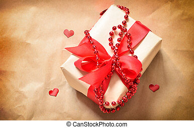 gift box with red hearts on a old table. Valentine day.