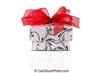 Gift box with red lace in white background