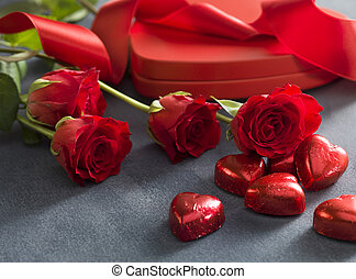 Gift box with red roses and chocolates. Valentines Day concept