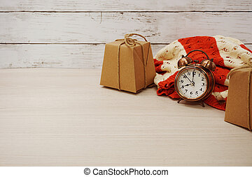 gift box with ribbon on wooden background