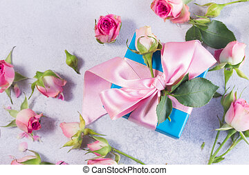 Gift box with satin bow and flowers