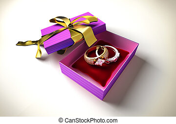Opened gift box with golden ribbon, with two precious rings, on a red pillow inside.