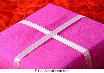 gift box with white ribbon on red background