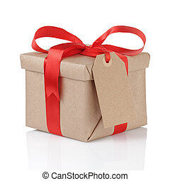 gift box wrapped with kraft paper and red bow with tag for ...