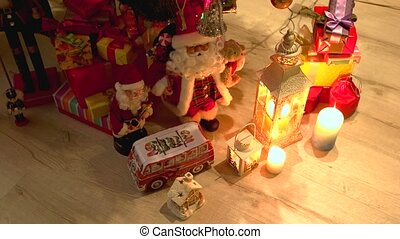 Gift boxes and Christmas decorations. Santa Claus toy, boxes...