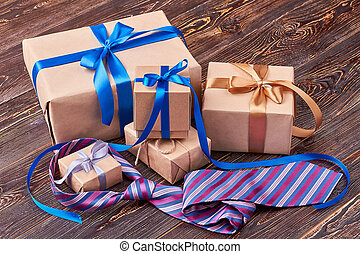 Gift boxes and striped tie.