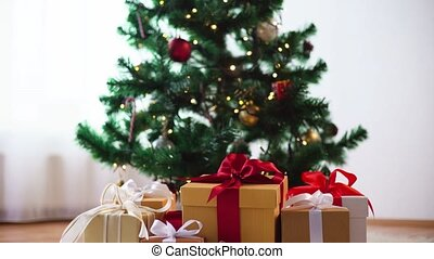 gift boxes at christmas tree - holidays, presents, new year...