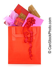 Gift boxes in a red shopping bag on white background