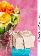 Gift boxes on a pink background.