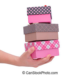 Gift boxes on hand over white background