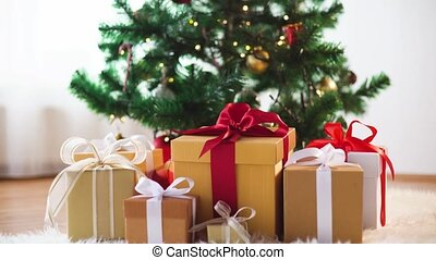 gift boxes on sheepskin at christmas tree - holidays,...