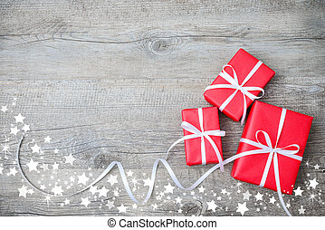 Gift boxes on wooden background - Gift boxes with bow and...