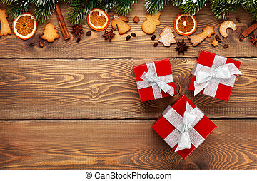 Gift boxes over christmas wooden background