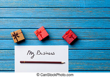 Gift boxes, pencil and paper with My Business words
