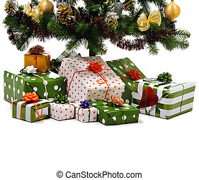 gift boxes under Christmas tree - gift boxes under decorated...