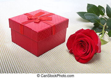 Gift boxes with bow and rose on white background. Decoration...
