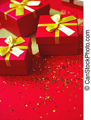 gift boxes with bow on red-gold background