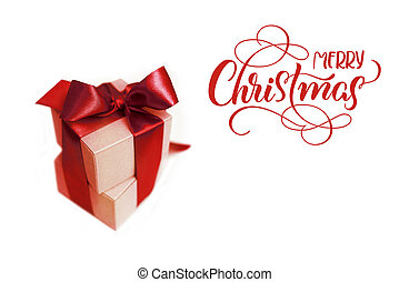 Gift boxes with brown bow on a white background and text Merry Christmas. lettering calligraphy