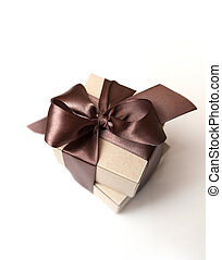 Gift boxes with brown bow on a white background