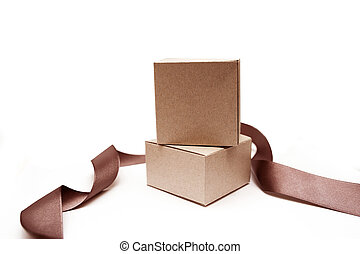 Gift boxes with brown ribbon on a white background