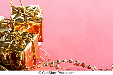 Gift boxes with Christmas decoration on a red background
