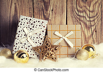 gift boxes with christmas decoration on wooden background