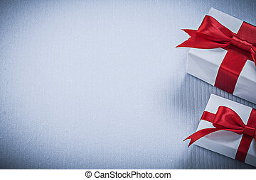 Gift boxes with red bow on white background holidays concept