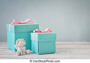 Gift boxes with statuette of angel - Blue polka dots gift ...