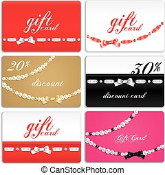 Gift cards decorated with ribbon and gems