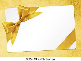 gift card with golden ribbon bow Isolated on yellow background