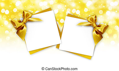 gift cards with golden ribbon bow Isolated on golden blurred lights christmas background