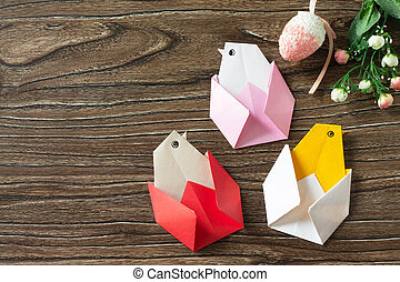 Gift Easter Origami Chicken. Handmade. The project of children's creativity, crafts, crafts for children. Copy space.