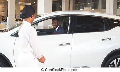 gift for beloved of man, surprise in car sales center. -...