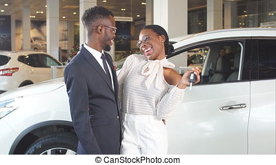 Gift for beloved of women, surprise in car sales center. -...