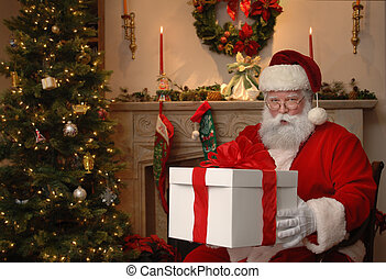 Gift from Santa - Santa next to a Christmas tree giving a...