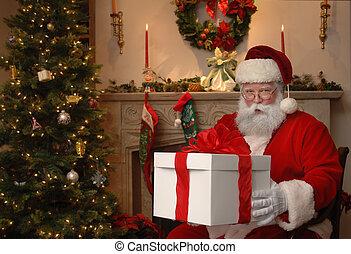 Gift from Santa - Santa next to a Christmas tree giving a...