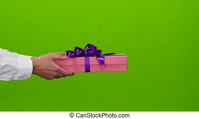Gift gift that is transmitted hand of the man. Studio - Gift...