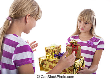 Gift giving stock photos and images 88410 gift giving pictures gift giving girl giving gifts to another girl negle Choice Image