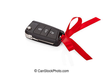 Gift idea: car keys with red ribbon isolated on white...