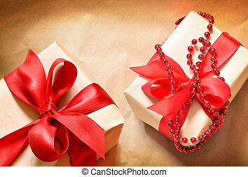 gift in a box with ribbon on wooden table