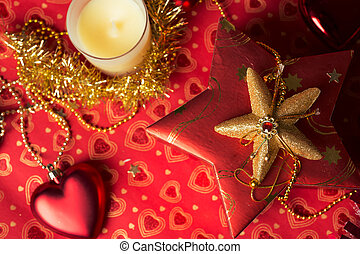 gift in box with christmas decoration at red background
