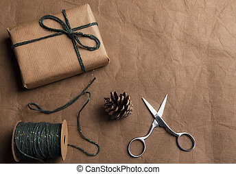 Gift in brown paper with string and scissors