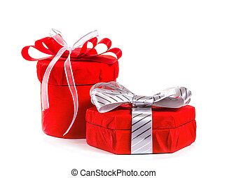 Gift in red box with a bow. Isolate on white background.