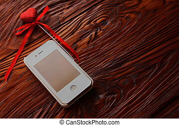 gift in the form of a phone with heart